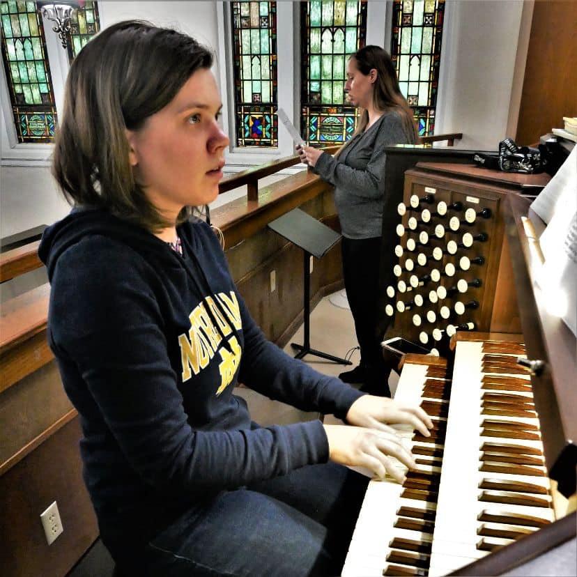 girl playing an organ